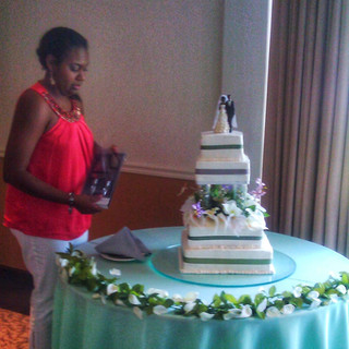 April sets up a wedding cake.