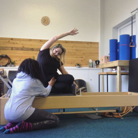 Side Bend on Pilates Reformer