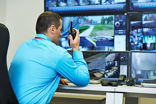 security guard watching video monitoring