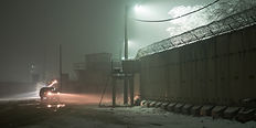 Military patrol at night along T Wall on