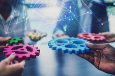 Group of people connect single colored cogwheels to make a gear. Teamwork, partnership and