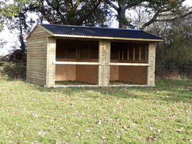 double badminton shelter with slip rails