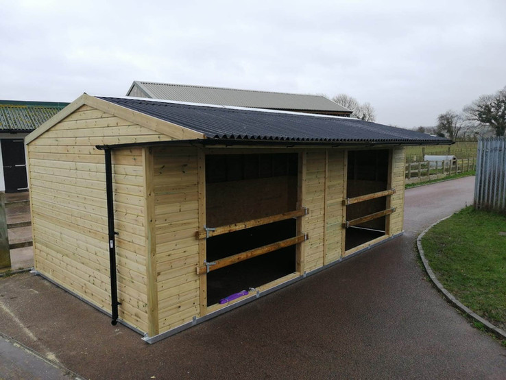 Double opening shiplap shelter with rail