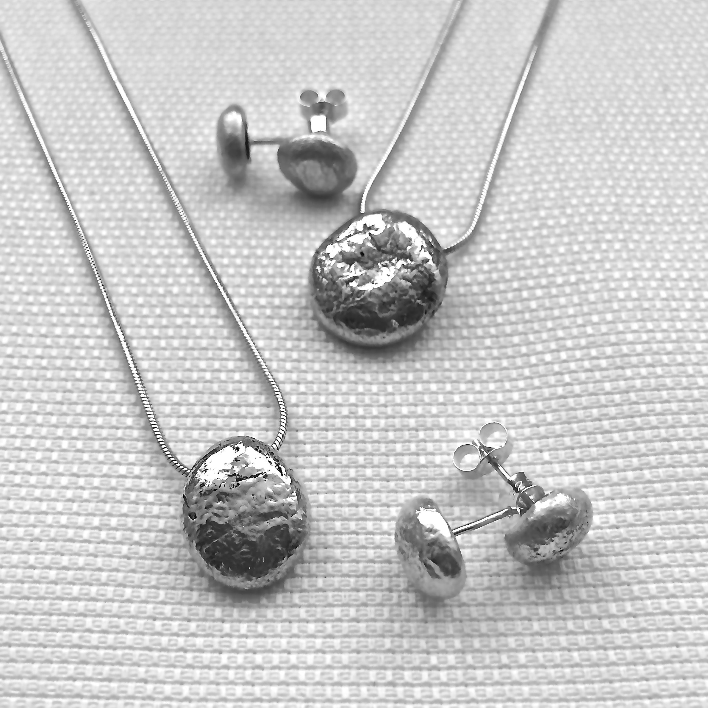 Pendants and studs© From £30