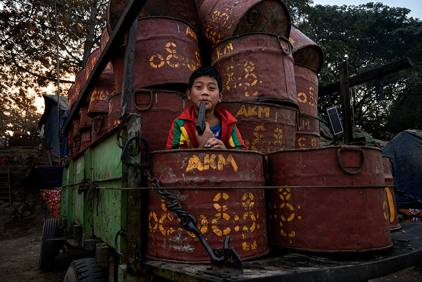 Burmese boy and his toy gun