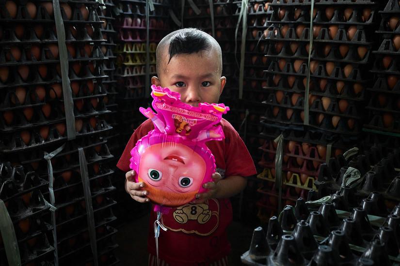 Burmese boy and his doll