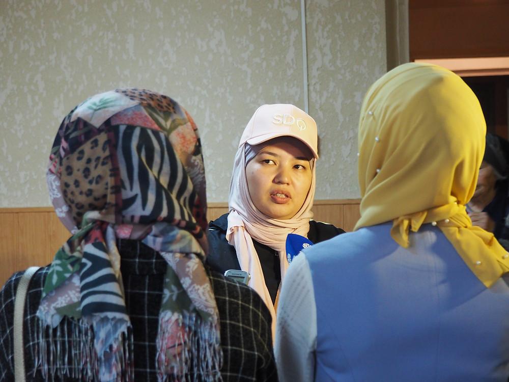 Eliana speaking with local news about Umma's volunteering efforts at a Bishkek nursing home.