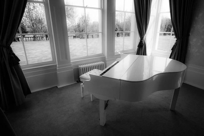 white-baby-grand-piano-seaham-hall.jpg