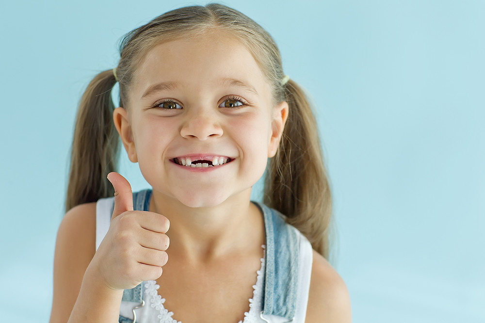 Is the Extra Point on My Child's Tooth Normal?