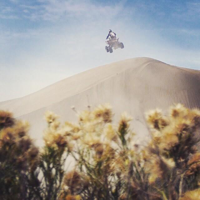 Instagram - Turn down for what?! #theatvworld #airitout #jump #dunes #quad #atv