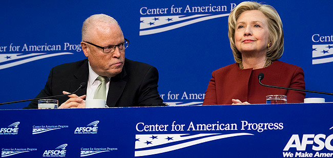 RACKET MAN: AFSCME President Lee Saunders was paid $348,745 last year with money taken from government workers. Here, he is seen last month with former Secretary of State Hillary Clinton at the Center for American Progress in Washington, D.C.