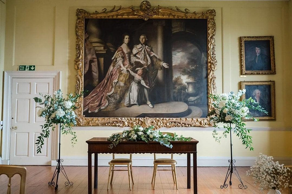 Our floral arrangements standing proud in the Long Gallery at Doddington Hall