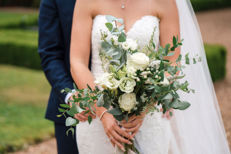 A wild, green & white handtied bouquet full of all our favourites