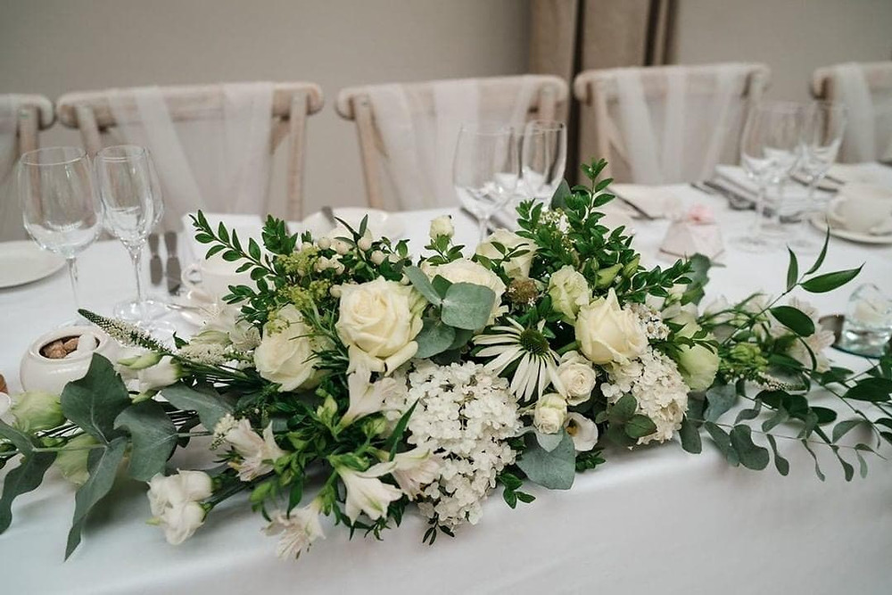 The table arrangements we make can easily be transferred to the head table for the wedding reception