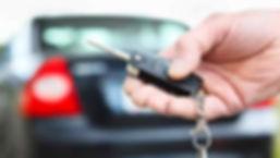 hand holding a car key.jpeg