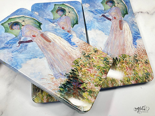 Monet style tin with minor dents/scratches