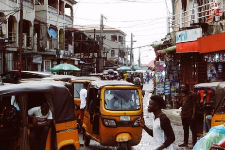 Narrow but Mighty, A Busy Street in Lagos