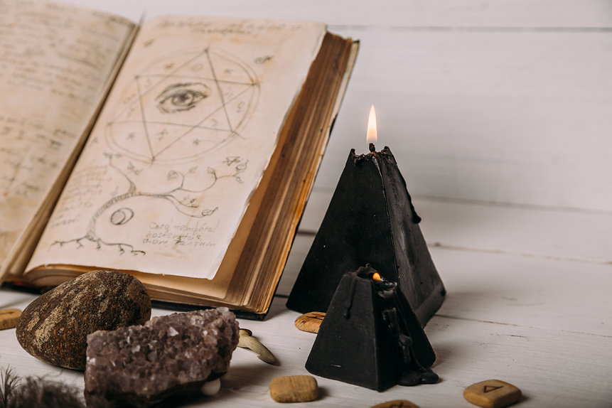open-old-book-with-magic-spells-runes-bl