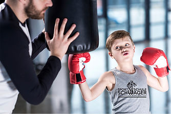 young-boy-boxer-practicing-punches-with-
