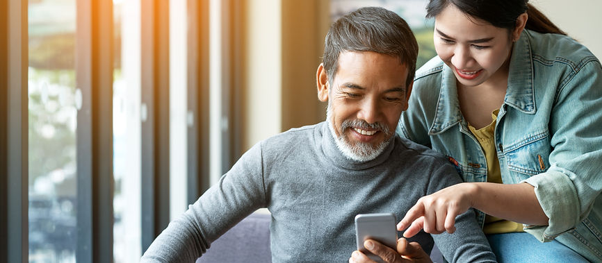 smile-attractive-stylish-short-beard-mature-asian-man-using-smartphone-with-young-woman.jp
