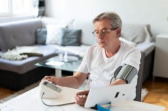 medium-shot-man-monitoring-hid-blood-pressure.jpg