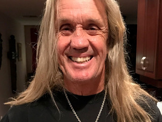 Iron Maiden's Nicko McBrain wearing LUGDUN ARTISANS