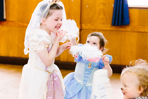 Two children in fancy dress play and dance at a super fun Theative Dance Party.