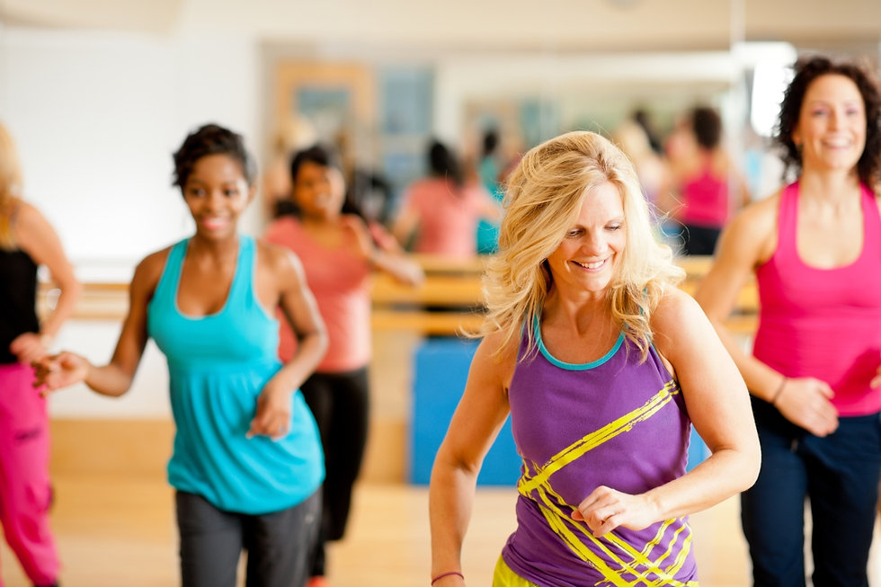Adult dancers having fun in a lively Theative dance fitness class in Streatham
