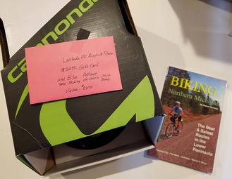 bike helmet and book