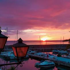 Sun rising at the port