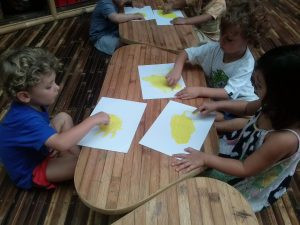 Finger painting to create Father Sun