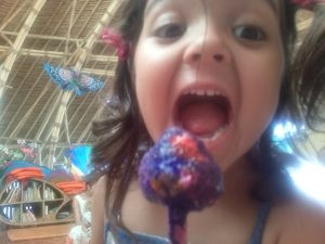 Here's Myla with her colorful lollypop