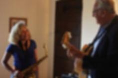 Jim Mullen playing guitar with Lynda Murray playing saxophone
