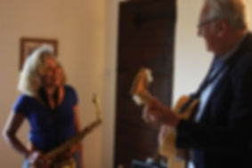 Jim Mullen playing guitar with Lynda Murray playing saxophone