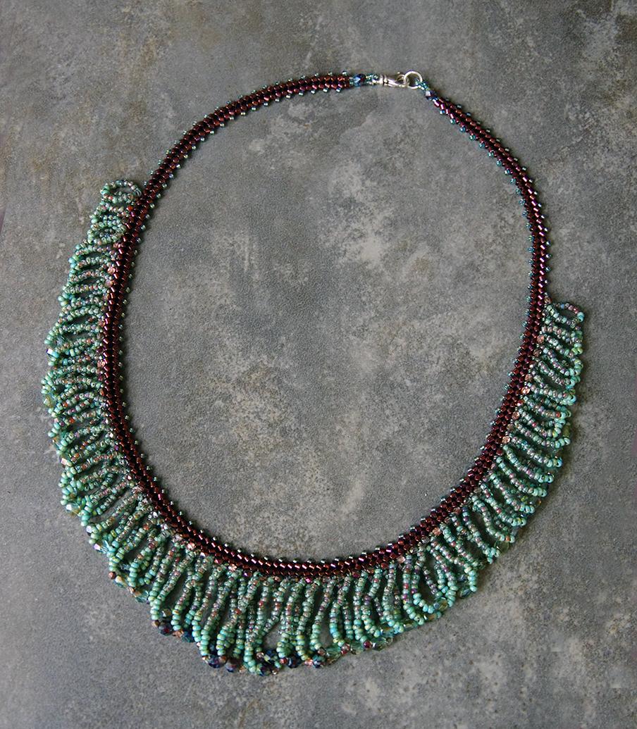 FRANGÉ Turquoise-bourgogne | 125 $