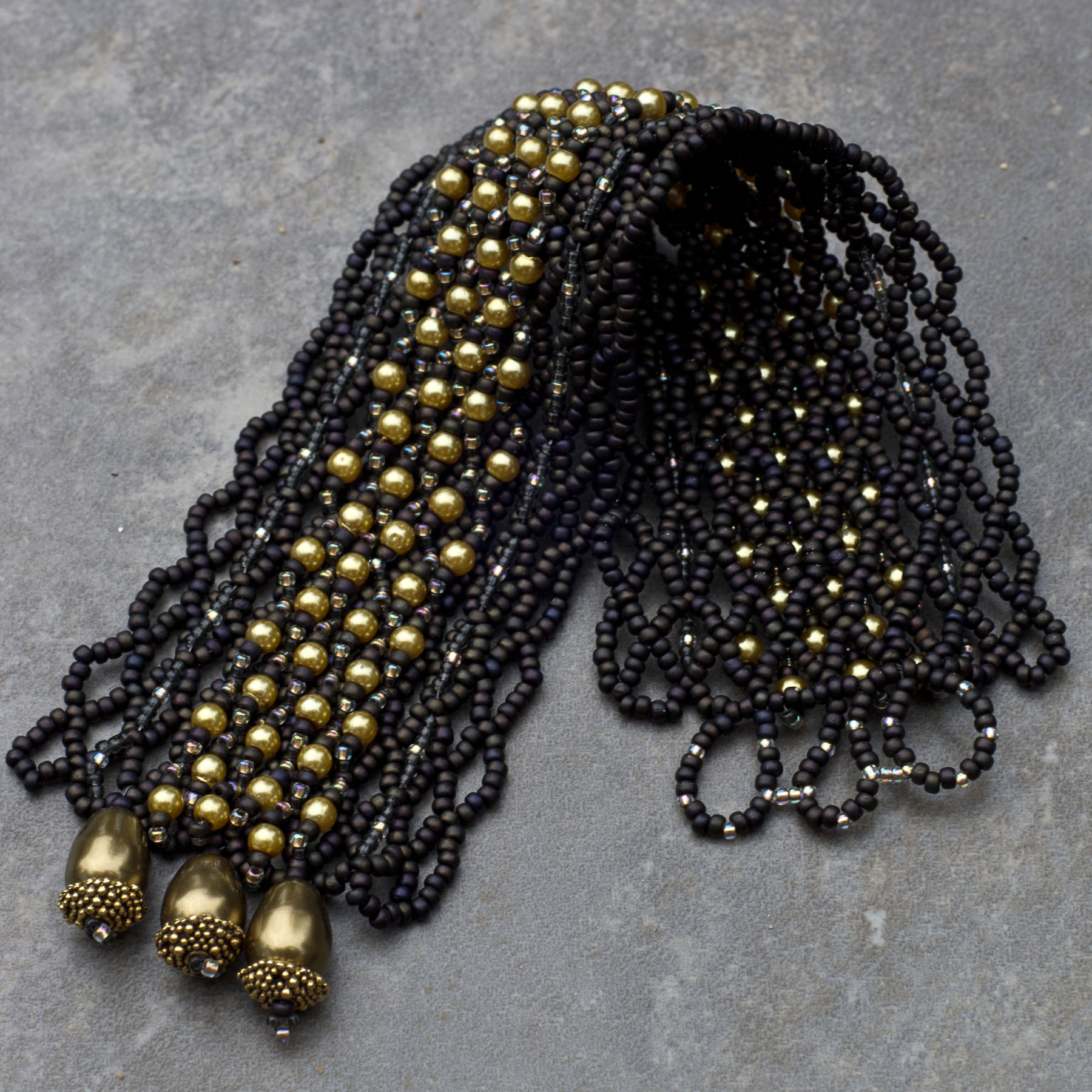 FILET AUX PERLES - Or et brun | 135 $