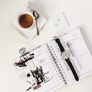 Planner and a cup of coffee, interview preparation