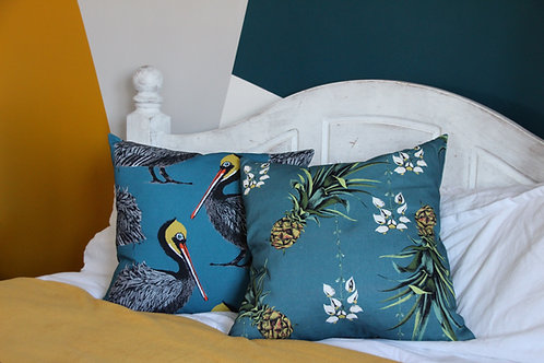 Pelicans cushion in Harbour blue