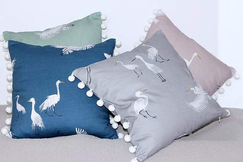 Egrets cushion with pom poms