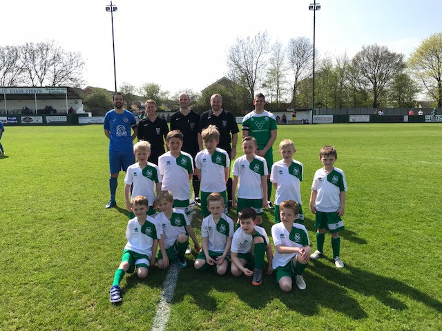 Street U8's were mascots for the day enjoying the sunshine and a half time penalty shoot out.