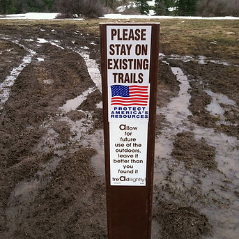 Please stay on existing trails photo