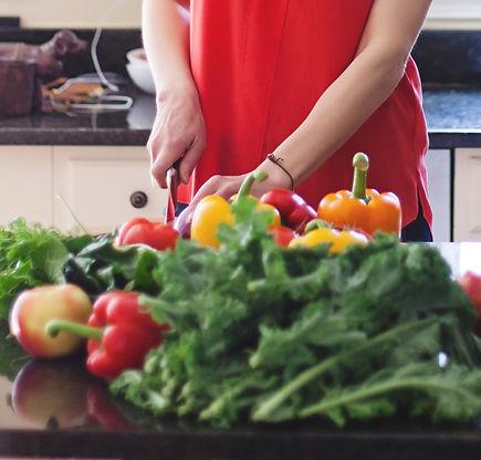 Kristin Kirkpatrick chopping vegetables