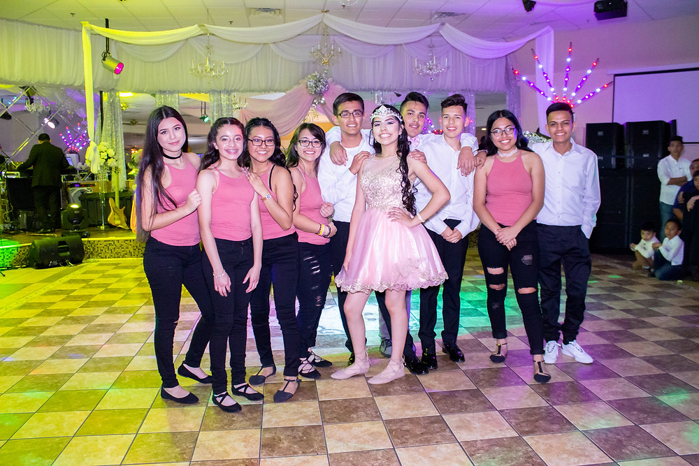 Quinceañera with her dames and chambelanes