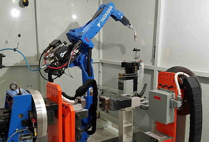 Blue robotic arm weld fixture