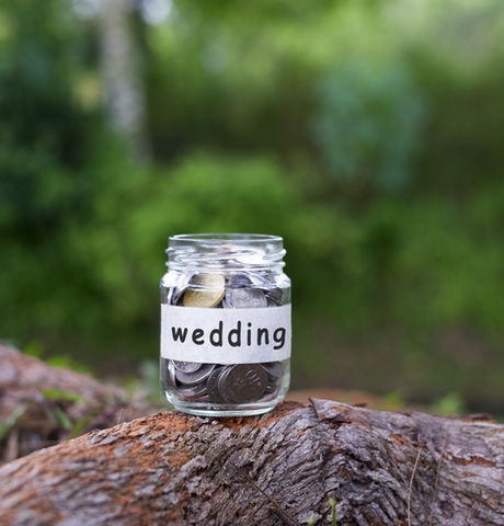 Coins in glass with WEDDING label agains