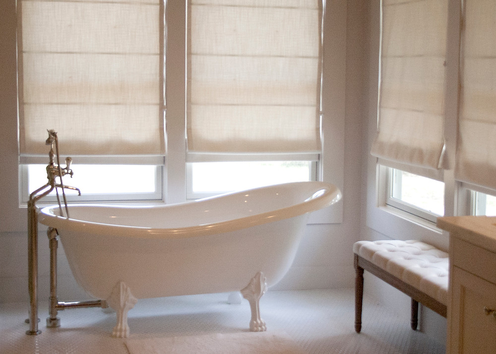 all white room with white bathtub and white paint color