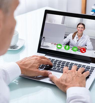 Businessman's Hand Videoconferencing Wit