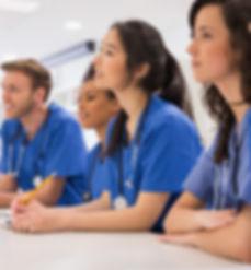 Medical students listening sitting at de