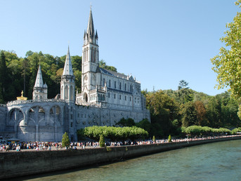 Travel to Lourdes — with Across