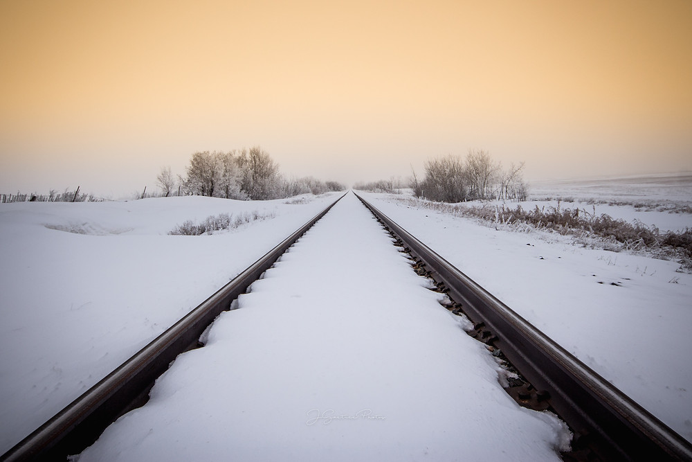 Train tracks across the prairie
